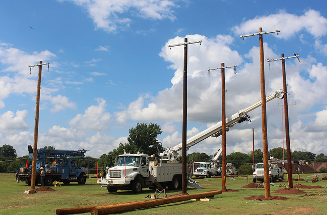 Photo of poles being set at Boomer Lake Park for the 2018 MESO Lineworkers Rodeo