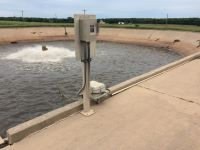 Flow Equalization Basin at the Wastewater Treatment Plant filled with water.